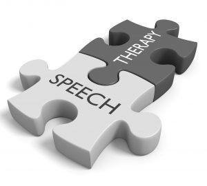Conceptual image for topics about treating communication impairment, featuring two connected puzzle pieces with the words speech therapy.